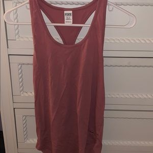 Burgundy tank top with a cross in the back